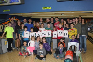 Little and big PALs thank their sponsors at the PAL Chanukah bowling party in 2015.