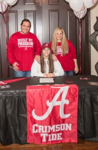 Alex Plavin celebrates signing with Alabama on Feb. 3.