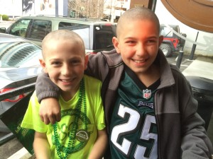 Simmy Wilson and brother Mikey are shown after getting their heads shaved for St. Baldrick's last year.