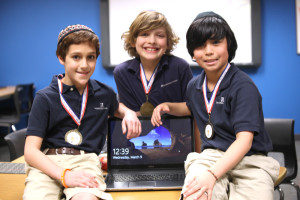 The Epstein School's (from left) Gavin Brown, Shai Bachar and Dylan Wendt placed in the top three in their categories at the Georgia Educational Technology Fair.