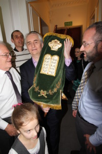 A Torah written in Poland that wound up in New Castle, Pa., returns to Poland for its first Shabbat in its new congregation in Warsaw on April 8.