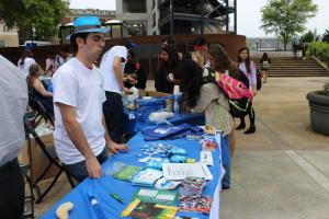 Robert Cohen of Marietta staffs an Israel Fest handout table.