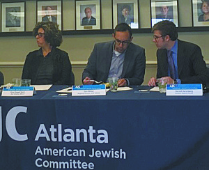 Dina Siegel Vann joins AJC Atlanta Regional Director Dov Wilker (center) and Assistant Regional Editor Harold Hershberg at a lunch with Latino leaders May 9.