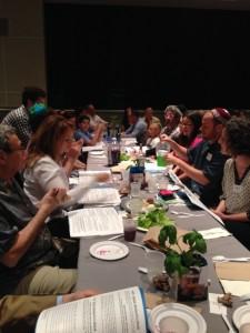Seder participants take turns washing hands.