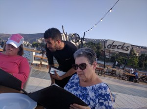 Photo courtesy of Chabad of Peachtree City Susan Shapiro studies the menu at Decks in Tiberias on June 2, three days before her death.