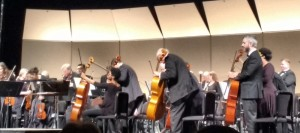 Members of the DeKalb Symphony Orchestra prepare to play.