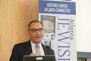 AJT Editor Michael Jacobs welcomes guests to the June 15 Jewish Breakfast Club