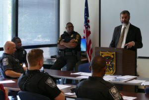 """""""We respect and honor everything that you stand for,"""" Beth Jacob Rabbi Ilan Feldman tells DeKalb police officers."""