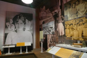 "A large photo of Mary Phagan, the 13-year-old Marietta girl Leo Frank was convicted of killing, overlooks the section of the ""Gatheround"" exhibit devoted to child labor and Frank's lynching."