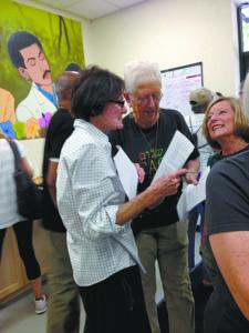 Jewish Community Relations Council of Atlanta board member Lois Frank strategizes with World Pilgrims Program Director Jan Swanson.