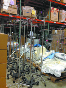 IV poles are ready to be shipped from the MedShare warehouse.