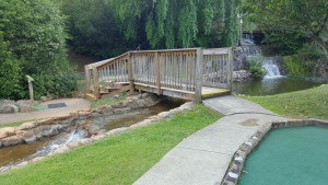 A quaint bridge and waterfall are part of the charm of Mountasia in Marietta.