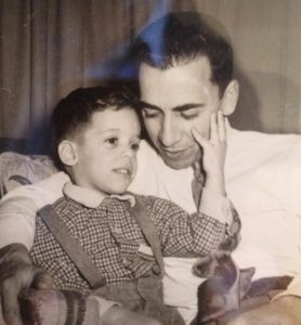 Mario Foah sits with son Robert in 1954 and stands beside him now on a balcony overlooking Buckhead.