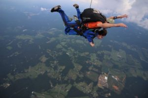 Nesie Summers is accompanied on the way down during a tandem jump.