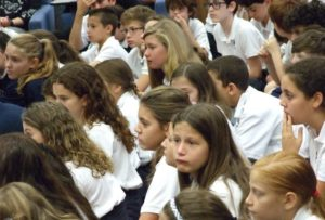 Davis Academy sixth- and seventh-graders react to the Caynes' story.