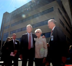 Bernie and Billi Marcus stand between son Fred Marcus (left) and Grady Memorial Health Chairman Frank Blake outside the Marcus Trauma & Emergency Center.