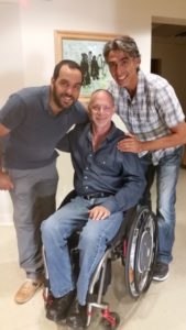 Raffle winner Eran Israel (left) gets the good news from Mitchell Tepper (center) and Anthony Naturman in late August.