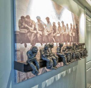 The previous owner of the home left this combination of a sculpture and a sepia-toned photo of workmen at New York's Rockefeller Center.