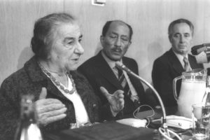 PRES. ANWAR SADAT (C) LISTENING TO MRS. GOLDA MEIR AND SHIMON PERES DURING HIS MEETING WITH THE ALIGNMENT FACTION.