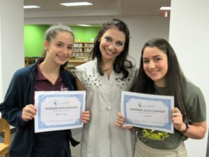 Rebecca Lewyn (left) and Jolie Abadi show their Creative Communication poetry certificates with teacher Anna Mogilevsky Lefkoff.