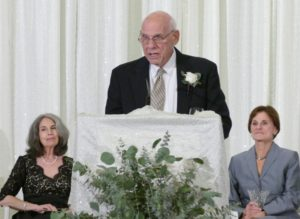 Larry Frank accepts the centennial honor on behalf of his later mother, Rae, while his wife, Lois, and Phyllis Cohen listen.