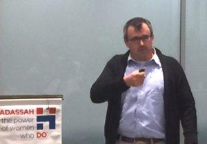 Joshua Schroeder talks during the Hadassah dessert reception.