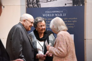Marine Corps veteran Alton Cadenhead, who met FDR as a child, and his wife talk with home front worker and war bride Tooken Richardson Cade. (Photo courtesy of the Museum of History and Holocaust Education)