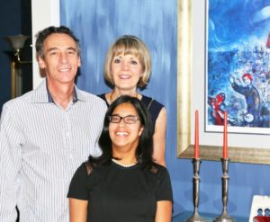 Sarah Kalins enjoys Shabbat with parents Jeff and Karen.