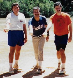 During the 1993 JCC modified fast-pitch softball season, Jody Blanke (right) and Jack Arogeti (left) flank fellow pitcher Gene Benator on the mound at the old Atlanta JCC fields.