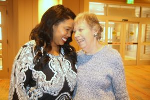 Photo by R.M. Grossblatt Erin Barbee likes hugs from residents such as Terry Bassner.