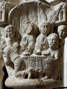 In a scene from Genesis depicted in a 12th century stone sculpture in Spain's northern Catalunya, Abraham entertains three visitors who turn out to be angels.