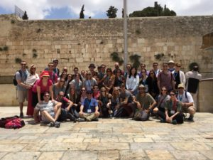 The HMI Atlanta group takes a photo at the Western Wall.