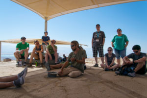 Koren Eisner teaches the group about Masada after climbing up the Snake Path.