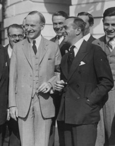 "Al Jolson (right), laughing with President Calvin Coolidge on Oct. 17, 1924, was one of America's top entertainers even before he opened his mouth and was actually heard by the audiences of ""The Jazz Singer."""