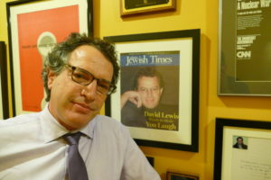 David Lewis has a framed copy of the cover of the Feb. 27, 2004, issue of the Atlanta Jewish Times, which profiled his Comedy for Peace project.