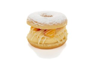 """A white chocolate peach """"burger"""" at Sublime adds ice cream to the fried pleasure of a filled doughnut."""