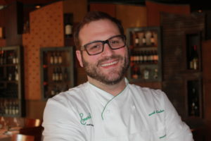 Communication After a cooking journey, David Slater has brought touches of Israel to the menu at Emeril's, where he is the chef de cuisine. (Photo courtesy of Deveney)