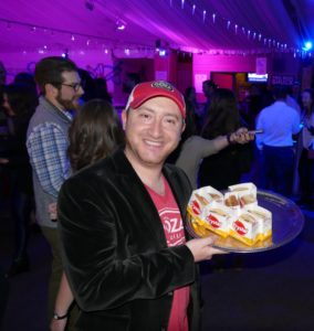 Goza Tequila co-founder Adam Hirsch passes out Krystal burgers.