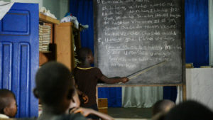 "Students among Ghana's Sefwi people study the Amidah in ""Doing Jewish,"" being screened Feb. 5 and 9."