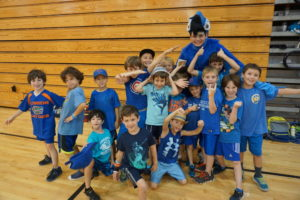 Kid Camp participants dress in blue for a color war.