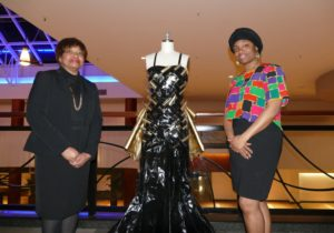 Photo by Sarah Moosazadeh Clark Atlanta fashion designer Cynthanie Sumpter (left) and one of her students, senior LeNora Clarice, flank the memorial dress they fashioned to commemorate Kristallnacht.
