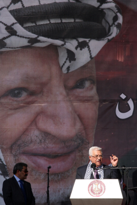 The two no's. Mahmoud Abbas waves to supporters on the sixth anniversary of the death of Yasser Arafat (photo credit: Issam Rimawi/Flash90)