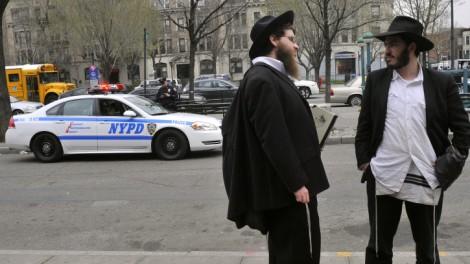 Ultra-Orthodox Jews converse in Crown Heights, Brooklyn, New York (photo credit: Serge Attal/Flash90)