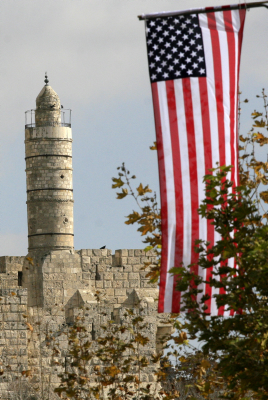 The Tower of David is seen behind an American flag (photo credit: Olivier Fitoussi /Flash90)