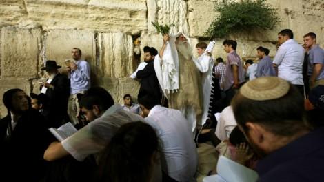 Orthdox men pray at Jerusalem's Western Wall on Tisha B'Av (photo credit: Kobi Gideon/Flash90)