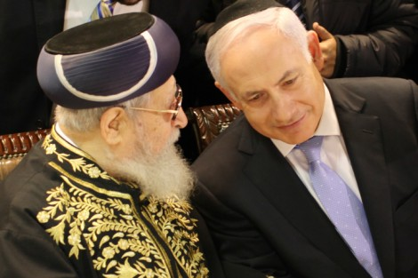 Prime Minister Benjamin Netanyahu and Rabbi Ovadia Yosef chat at the bar mitzva meal of the son of Interior Minister Eli Yishai in Jerusalem, February 3, 2011 (photo credit: Ilia Yefimovich/Flash90)