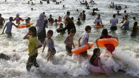 Palestinians enjoy the beach in Rafah, the southern Gaza Strip, June 2012 (photo credit: Abed Rahim Khatib/Flash 90)