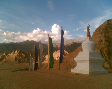 Buddhist chorten (monument) and prayer flags in the barren mountains of Choglamsar, 10 km. from Ladakh's capital of Leh (photo credit: Gavin Gross)