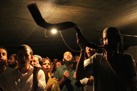 Radical times. Jewish worshipers blow the shofar and pray in the Judean Desert ahead of Rosh Hashanah (photo credit: Nati Shohat/Flash90)