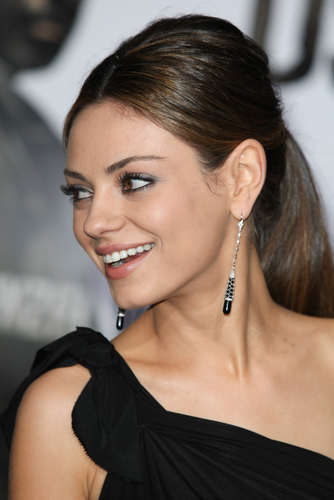 Mila Kunis (via Shutterstock)